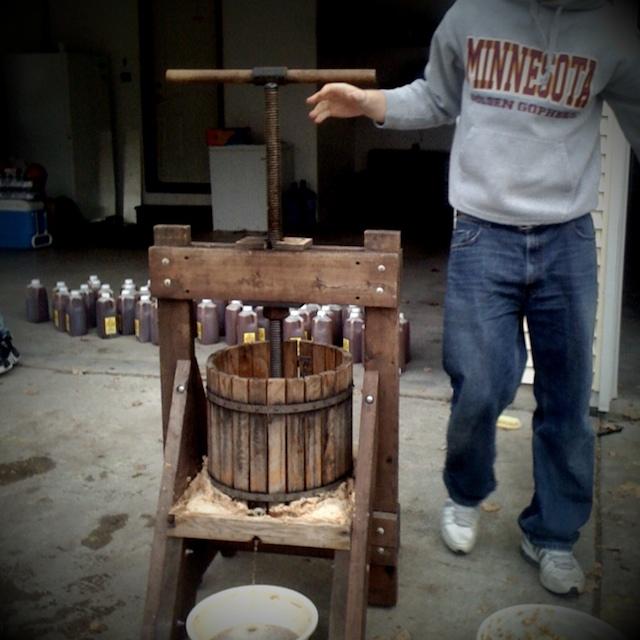 Luke mans the cider press