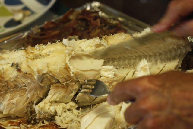 Lift fish off the bones to a platter