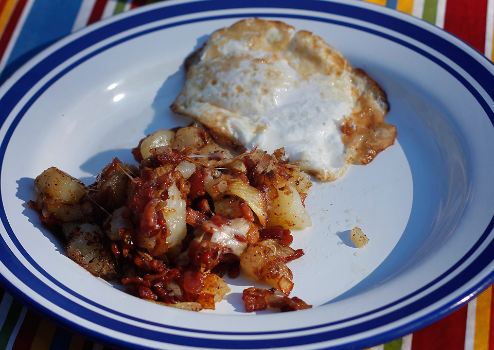 Morgan's bacon, potato hash with an egg.